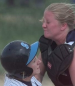 Magruder catcher Lisa Conner grimaced as she collided with Springbrook runner Caitlin Miller at Magruder High